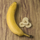 Fresh natural banana bunch. Fresh and natural banana Tabasco on wood table Royalty Free Stock Photo