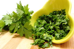 Fresh, natural and chopped parsley on wooden cutting board Royalty Free Stock Photo