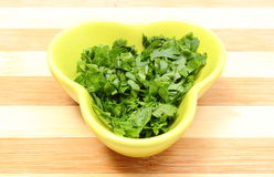 Fresh and natural chopped parsley in yellow dish Stock Photography