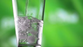 Fresh natural cool water pour into glass slow motion with bubbles. Water pouring into glass slow motion fresh natural cool with bubbles. This type of clips could stock video footage