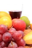 Fresh natural fruits and glass of juice on cutting board Stock Photos