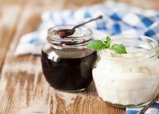 Fresh natural homemade yogurt on rustic wooden background. Fresh natural homemade yogurt with blueberru jam on rustic wooden background, copy space Royalty Free Stock Image