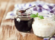 Fresh natural homemade yogurt on rustic wooden background. Fresh natural homemade yogurt with blueberru jam on rustic wooden background, copy space Royalty Free Stock Images