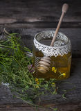 Fresh natural honey in a jar with honey spoon on vintage wooden Stock Images