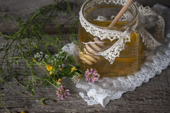 Fresh natural honey in a jar with honey spoon on vintage wooden Stock Photos