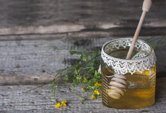 Fresh natural honey in a jar with honey spoon on vintage wooden Royalty Free Stock Photography