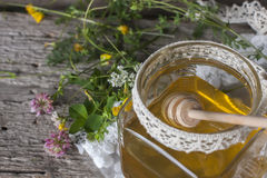 Fresh natural honey in a jar with honey spoon on vintage wooden Stock Image