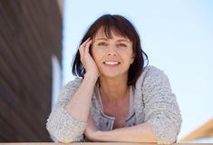 Fresh natural older woman smiling outdoor Royalty Free Stock Photo