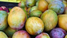Fresh, Natural, Organic Mangoes on Display at a Farmers` Market. A colorful display of fresh, organic mangoes for sale at the Mahane Yehuda market in Jerusalem Royalty Free Stock Photography