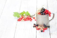 Fresh natural organic red white and black currants in a mug on a. Wooden table  seasonal berries Stock Photo