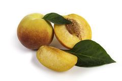 Fresh natural peach. Portions and leafes Stock Image