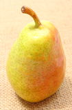Fresh and natural pear on jute canvas Royalty Free Stock Photo