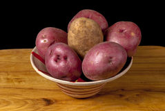 Fresh natural potatoes in a bowl Stock Photos
