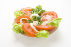 Fresh natural salad bowl tomato lettuce onion Stock Photo