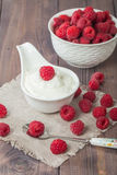 Fresh natural yogurt with raspberries Royalty Free Stock Photography