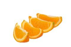 Fresh Navel Orange Slices Isolated on White. Four fresh navel orange slices isolated on a white background Stock Photo