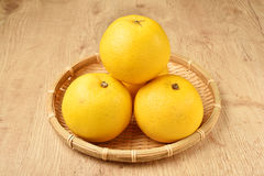 Fresh navel oranges. Pile of stacked  navel oranges in a bambo basket Royalty Free Stock Photography