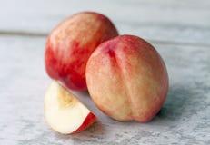 Fresh nectarine on wood background Stock Images