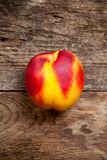 Fresh nectarine on wooden table Stock Images