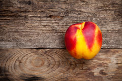 Fresh nectarine on wooden table Stock Photography