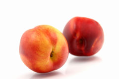 Fresh nectarines. On white background Stock Photo