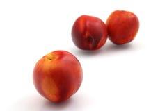 Fresh nectarines. On white background Royalty Free Stock Photo