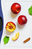 Fresh nectarines on a board Royalty Free Stock Photo
