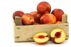 Fresh nectarines and a cut one Stock Images