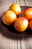 Fresh nectarines in a plate Stock Image