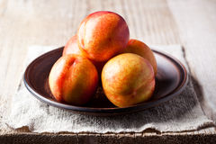 Fresh nectarines in a plate Stock Photography