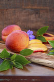 Fresh nectarines on rustic wood background. Royalty Free Stock Images