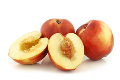 Fresh nectarines and two halves Stock Photography