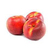 Fresh nectarines on a white background. Stock Photography
