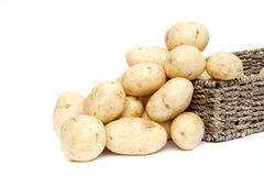 Fresh new potatoes in rustic basket Royalty Free Stock Photography