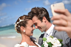 Fresh newly-weds taking selfie Stock Photos