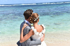 Fresh newly-weds in wedding dresses on caribbean islands royalty free stock photos