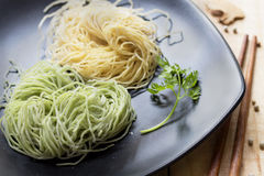 Fresh noodles with eggs on Ceramic plate. Stock Image