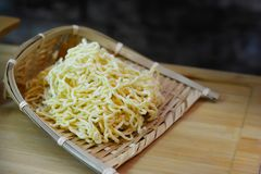 Fresh noodles homemade in bamboo weave royalty free stock photography