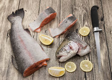 Fresh Norwegian rainbow trout steaks with lemon lies on a wooden background Stock Image