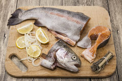 Fresh Norwegian rainbow trout steaks. With lemon lies on a wooden background Royalty Free Stock Images