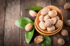 Fresh nutmeg. On the wooden table Stock Photography