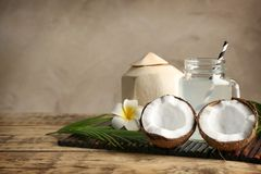 Fresh nuts and mason jar with coconut water. On bamboo mat Royalty Free Stock Photos