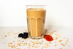 Fresh oat protein smoothie drink cocktail with fruits on white background. Side view. Text copy space stock photos