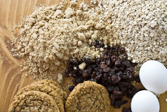 Fresh oatmeal cookies with baking ingredients. Overhead view of fresh oatmeal cookies with baking ingredients Stock Photography