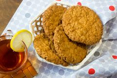 Fresh oatmeal cookies. Delicious and healthy Breakfast. Invigorating hot tea with fresh lemon. royalty free stock image
