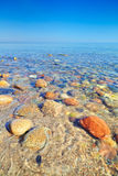 Fresh ocean water with beautiful stones Baltic sea Royalty Free Stock Photos