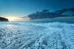 Fresh ocean waves at sunset Stock Image