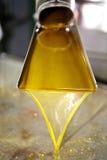 Fresh oil flowing in the bin Stock Photo