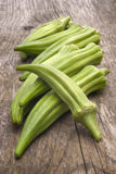 Fresh Okra (Abelmoschus esculentus). On wooden table Royalty Free Stock Photo