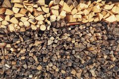 The fresh and old firewood laid in a woodpile. The fresh firewood laid from above old firewood and prepared for the furnace Royalty Free Stock Photo